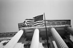 American Flag (Andrew H Wagner | AHWagner Photo) Tags: olympusxa2 olympus xa2 pointandshoot pointshoot 35mm film bw blackandwhite blackwhite monochrome monochromatic thefindlab grain grainy filmgrain analog filmshooters find filmphotography analogfilm dc washingtondc districtofcolumbia cinestillbwxx cinestill bwxx doublex eastmandoublex streetphotography street candidphotography candid usa flag usaflag americanflag america american building architecture