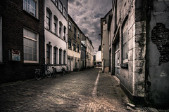 urban decay (bjdewagenaar) Tags: photography photograph photographer photooftheday sony sonyalpha sonyphotographer sonyimages sonya77ii sonya sigma wideangle ultrawideangle city urban street streetphotography decay buildings clouds sky pavement bricks perspective raw lightroom