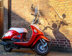 Shadow on the wall - Flash (Robica Photography) Tags: robicaphotography streetphotography straatfotografie streetart 2018 tilburg pavement d3200 shadow scooter wall bricks red