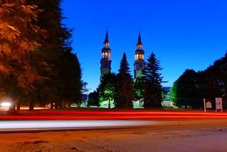 Car Passing Montreal's Historic Church de la Visitation at Twilight