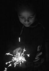 Amazed by the Light (Airborne Guy) Tags: child boy firework sparkler monochrome dark bw bnw blackandwhite holiday fun