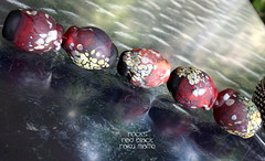 Rocks Red Black Raku Matte (Laura Blanck Openstudio) Tags: openstudio openstudiobeads glass handmade lampwork murano fine art arts artist artisan beads set opaque matte frosted etched glow glowing rocks nuggets pebbles stones whimsical funky odd abstract asymmetric speckles frit raku ocher red coral black dark lilac lavender grape purple violet gray off white sand eggplant plum mauve aqua bold bright contemporary unique rare big huge burgundy wine bordeaux colorful multicolor