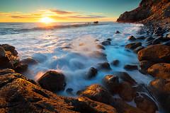 Splashdown (robjdickinson) Tags: water rock ocean nature sea beach sky landscape dawn coast wave sunrise sun outdoor bodyofwater seashore rocky seascape horizon travel noperson
