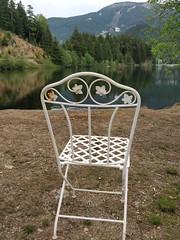 Lakeside seat (Ruth and Dave) Tags: whistler whistlerblackcomb whistlervalley tamarisk alphalake chair seat foldingchair rusting pretty white lake grass mountain valley