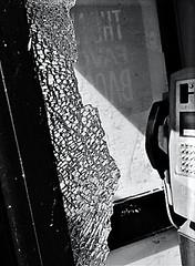 mindless (Mr Ian Lamb 2) Tags: phone telephone box kiosk vandalism broken glass shattered damage mono monochrome bandw