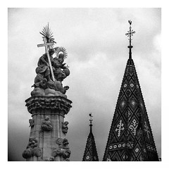 Where the Wind blows (Thomas Listl) Tags: thomaslistl blackandwhite biancoenegro noiretblanc statue trinity budapest hungary 100mm square grain church architecture roof crucifix matthiaschurch rooster weathervane sky clouds