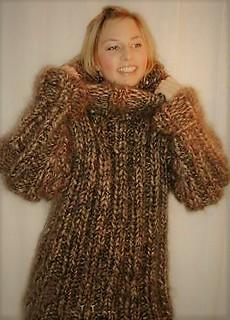 Sexy blonde girl in turtleneck knitwear