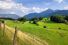 Oberbayern - Upper Bavaria (rotraud_71) Tags: germany bavaria upperbavaria berchtesgadenerland anger landscape summer mountains meadows fence farmhouse hut sky clouds