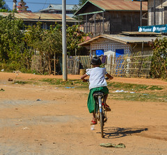 A student biking on rural road (phuong.sg@gmail.com) Tags: aged ancient antique architecture asia asian beautiful bicycle bike burma child children city culture cycle heritage hoian house indochina landscape lifestyle myanmar old outdoor peaceful people street tourism tourist town tradition traditional transportation travel unesco vacation vietnam vietnamese wall woman world yellow