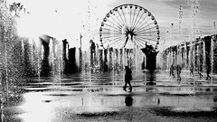 water game (heinzkren) Tags: springbrunnen rad street streetphotography scharzweis blackandwhite bw sw monochrome outdoor water urban silhouette riesenrad fountain wheel giantwheel wet rain reflection spiegelung nice nizza france panasonic lumix city
