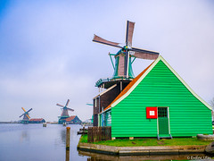 Windmills in Holland (✦ Erdinc Ulas Photography ✦) Tags: mill mills windmill windmills zaanse schans zaandam city traditional panasonic culture old dutch holland nederland netherlands water reflection bay wood building landmark molen windmolen focus landscape sky