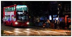 Night Life (M C Smith) Tags: bus red night route 212 walking drinking bar cafe pentax kp crossing black white kerb pavement trees green bush orange sign glow lights reflections seats seating chairs tables lines shadows