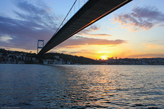 A bridge over...? (Anthony P.26) Tags: architecture bosphorus category istanbul places seascape sunset travel turkey bridge fatihsultanmehmetbridge water straits waves clouds outdoor sky sun glow perspective lines angle travelphotography skyline city cityscape canon550d canon canon1855mm