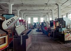 Arcade Graveyard (Scuffles33) Tags: mamiya645 portra400 mediumformat filmphotography 120film abandoned factory vintage arcadegames atari