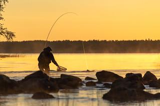Fisherman on river mouth in Nurmijoki river