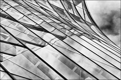 Vienna abstract - diagonal (Armin Fuchs) Tags: arminfuchs vienna wien house architecture diagonal windows clouds stripes skyscraper lines curves