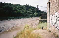 The slipway before the Floating Harbour (knautia) Tags: riveravon bristol england uk july 2018 film ishootfilm olympus xa2 olympusxa2 kodak kodacolor 200iso nxa2roll34 river avon mud cliftonsuspensionbridge bridge slipway graffiti lowtide