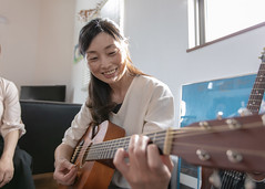 Woman playing the guiter at home party (Apricot Cafe) Tags: img88787 asia asianandindianethnicities canonef1635mmf28liiusm healthylifestyle japan japaneseethnicity kanagawaprefecture adult artscultureandentertainment backlit beautifulwoman communication connection day diningroom domesticlife enjoyment friendship guitar happiness homeinterior indoors leisureactivity lifestyles livingroom midadult music musician oneperson onlywomen partysocialevent people photography playing practicing realpeople smiling springtime sunlight sustainablelifestyle teamwork togetherness toothysmile waistup women