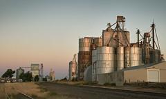 Grain Elevators (Clay Fraser) Tags: grainelevators railroad cheyennewells colorado greatplains sunrise fujifilm xpro2 xf1655mm pinconnected cheyennecounty cargilgraincompany