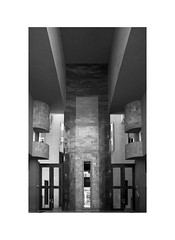 Walden 7 3 (2 Marvelous 4 Words (Blanca Gomez)) Tags: spain bcn barcelona santjustdesvern bw blackwhite arquitectura architecture apartments ricardobofill houses housing flats 18towers towers labyrinth gate reflection glass