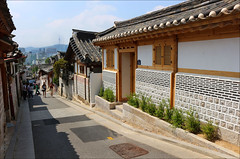 Bukchon Hanok Village (roll the dice) Tags: southkorea korean asian amazing magic art classic holiday travel fareast mad fyn funny surreal hanriver kpop won hangul lights colour urban view architecture canon tourism tourists culture hot sunny weather sky 한옥 joseondynasty history dwelling alleys 서울시 gyeongbokgungpalace nseoultower old shadows light people noisy crowd home windows unique