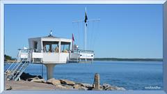 Gottskär (4) a (andantheandanthe) Tags: sweden kungsbacka halland sky sea water boat boats recreasion recreation blue startingtower tower starting races flags rocks