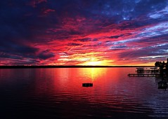 Sunset on the Water (SkyeHar) Tags: sunset lake sun water colorful sky colors dock iphone waterscape clouds shadows light sunlight silhouette scenery red storm weather colours vivid