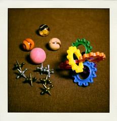 Still Life with Toys (N.the.Kudzu) Tags: tabletop stilllife toys marbles jacks puzzles canon70d manualfocus primelens lensbabyburnside35 poladroid