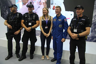 Tim Peake and Suzie Imber pose a photo with the some of the police team