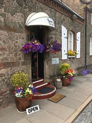 Entrance to the Craft Shop at Drigg Railway Station. (Bennydorm) Tags: lovely building open copeland railwaystation pavement inghilterra inglaterra angleterre europe uk gb britain england cumbria drigg summer july iphone6s shop entrance attractive picturesque pretty flora flowers