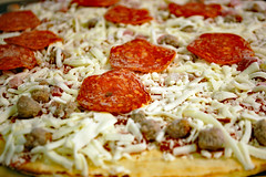 Pizza Before Entering The Oven. (dccradio) Tags: lumberton nc northcarolina robesoncounty indoor indoors inside food eat meal lunch dinner supper pizza frozen frozenpizza pepperoni ham canadianbacon cheese mozzarella sauce tomatosauce sausage tonys tonyspizza crust nikon d40 dslr