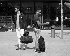 Different ways, same bag, same phone (Franco & Lia) Tags: street fotografiadistrada photographiederue berlin berlino alexanderplatz deutschland germany germania biancoenero schwarzundweiss noiretblanc blackandwhite stphotographia