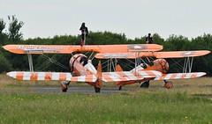 SE-BOG (1) and N74189 (2) (goweravig) Tags: n74189 sebog visiting aircraft wnas18 swanseaairport boeing stearman kaydet 1 2 aerosuperbatics wingwalkers biplane swansea wales uk