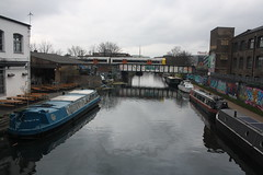 Barges and Overground (lazy south's travels) Tags: london hackney wick england english britain british uk river canal boat barge industrial industry transport londonoverground train bridge calm