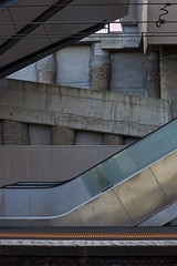 North Melbourne, Melbourne, Victoria, Australia. 2018-05-12 10:30:00 (s2art) Tags: canon5d dslr melbourne victoria australia pt metro northmelbourne station northmelbournestation brutalism concrete columns wires walll walls angles escalators staris stairs monotone grey shades form beauty fleetingglance innersuburbantrainstation westmelbourne pc3003 auspctageedpc3003 westmelbournepc3003 geometry line shape texture orangedots orange dots newtopographics topographics urban urbanenvironment urbanliving city cities publictransport utata:project=ip266 soft softlight brutal noir softbrutalnoirish
