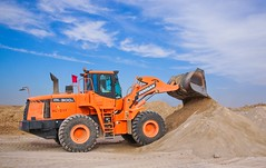 Orange Excavator on Brown Hill - Credit to http://homedust.com/ (Homedust) Tags: action blue sky bucket bulldozer clouds construction equipment excavator gravel ground heavy industry sand scoop shovel soil tractor transportation system truck vehicle