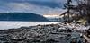 exposed island beach (kellypettit) Tags: rocks hard stones beach pebbles sand lighthouse nanaimo westcoast vancouverisland peaceful tranquil ocean sea clouds goldenhour magenta happyplace