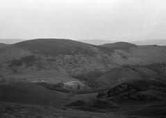 Shropshire hills (OhDark30) Tags: carl zeiss jena czj werra 3 tessar 2850 35mm film monochrome bw blackandwhite bwfp fomapan 200 rodinal shropshire hills hope bowlder caer caradoc landscape evening fields shadow lowsun summer