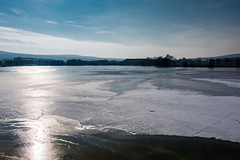 Frozen Lake (bhanakam) Tags: lake idyllic standing water tranquil scene waters edge jetty tranquility ice cold snow winter germany bavaria free state franconia sun bright sky clouds shine
