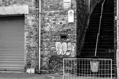 Stairway To no where (WorcesterBarry) Tags: bnw buildings street streetphotography streetphoto shadows steps painting graffitiart tags