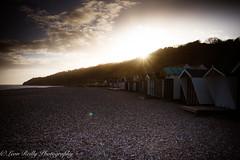 Lyme Regis Sunset (broadswordcallingdannyboy) Tags: copyrightleonreillyphotography sunset beach beachhuts dorset lymeregis flare magichour twilight landscape sun canon eos7d 1740mm light beautifullight sunlightsparkle seaside sea leonreilly spring donotcopy