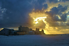Sunrise Rumble (Andy Zito) Tags: surise rumble gulf shores alabama bright sun light dark purple clouds beach sand buildings