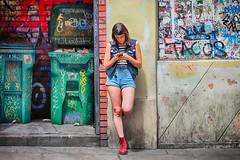 Kick Back (Ian Sane) Tags: ian sane images kickback woman leaning smartphone graffiti grit style candid street photography urban scene downtown portland oregon yamhill pub canon eos 5ds r camera ef100400mm f4556l is usm lens