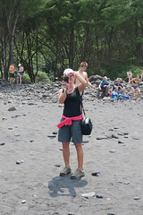 A picture of Kari taking a picture of me taking a picture of Kari (BarryFackler) Tags: pololuvalley northkohala bigisland hawaii hike nature outdoor hawaiiisland tropical polynesia hawaiicounty outdoors people smiling smile karihutton friend wahine photographer woman female beach blacksandbeach shore trees rocks sand coast valley laughing tourists blacksand sandwichislands barryfackler barronfackler 2018