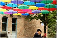 The Moment Together Under The Umbrella - Yaletown XP8082e (Harris Hui (in search of light)) Tags: harrishui fujixpro2 digitalmirrorlesscamera fuji fujifilm vancouver richmond bc canada vancouverdslrshooter mirrorless fujixambassador xpro2 fujixcamera fujixseries fujix fujixf55200mm fujizoomlens umbrella yaletown candid together street streetphotography streetcandid colors colorful artinstallation selfie stranger