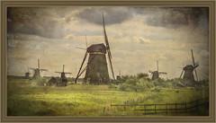 Kinderdijk(Netherlands) (williamwalton001) Tags: pentaxart nationalpark netherlands texture historic windmills sky stone grasses framed fineart fence daarklands