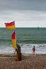 Littlehampton -E6160098 (tony.rummery) Tags: beach child em10 flag groyne littlehampton mft microfourthirds omd olympus sea seascape seaside shingle southcoast stormy sussex england unitedkingdom gb