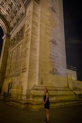 Stephanie reading about the history of the Arc de Triomphe.