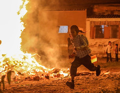 As much as fire frightens, it attracts… (ybiberman) Tags: israel jerusalem meahshearim lagbaomer bonfirefeast boy fire bonfire ultraorthodox jew payot running portrait candid streetphotography people