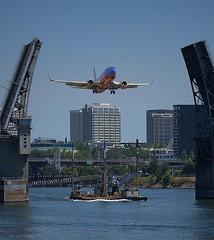 Open The Bridge (Scott 97006) Tags: drawbridge opened river water barge jet plane situation humor